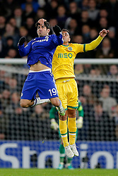 Diego Costa of Chelsea has his head pulled back by  Jonathan Silva of Sporting as they compete in the air - Photo mandatory by-line: Rogan Thomson/JMP - 07966 386802 - 10/12/2014 - SPORT - FOOTBALL - London, England - Stamford Bridge - Sporting Clube de Portugal - UEFA Champions League Group G.