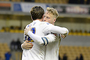 Preston North End defender Adam Reach and Preston North End defender Tom Clarke celebrate win during the Sky Bet Championship match between Wolverhampton Wanderers and Preston North End at Molineux, Wolverhampton, England on 13 February 2016. Photo by Alan Franklin.