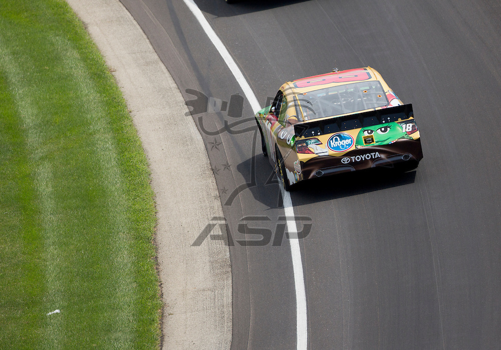 INDIANPOLIS, IN - JUL 29, 2012:  Kyle Busch (18) brings his car through the turns during the Curtiss Shaver 400 presented by Crown Royal Sprint Cup Series race at the Indianapolis Motor Speedway in Indianapolis, IN.