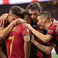 December 8, 2018 - Atlanta, Georgia, United States - Atlanta United defender FRANCO ESCOBAR (2), Atlanta United defender MICHAEL PARKHURST (3) \and Atlanta United midfielder MIGUEL ALMIRON (10) celebrate the first goal by Atlanta United forward JOSEF MARTINEZ (7) during the MLS Cup at Mercedes-Benz Stadium in Atlanta, Georgia.  Atlanta United defeats Portland Timbers 2-0 (Credit Image: © Mark Smith/ZUMA Wire)