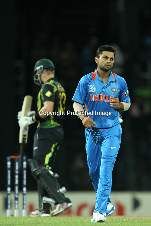 Virat Kholi reacts after bowling during the ICC World Twenty20 Super 8s match between Australia and India held at the Premadasa Stadium in Colombo, Sri Lanka on the 28th September 2012<br /> <br /> Photo by Ron Gaunt/SPORTZPICS