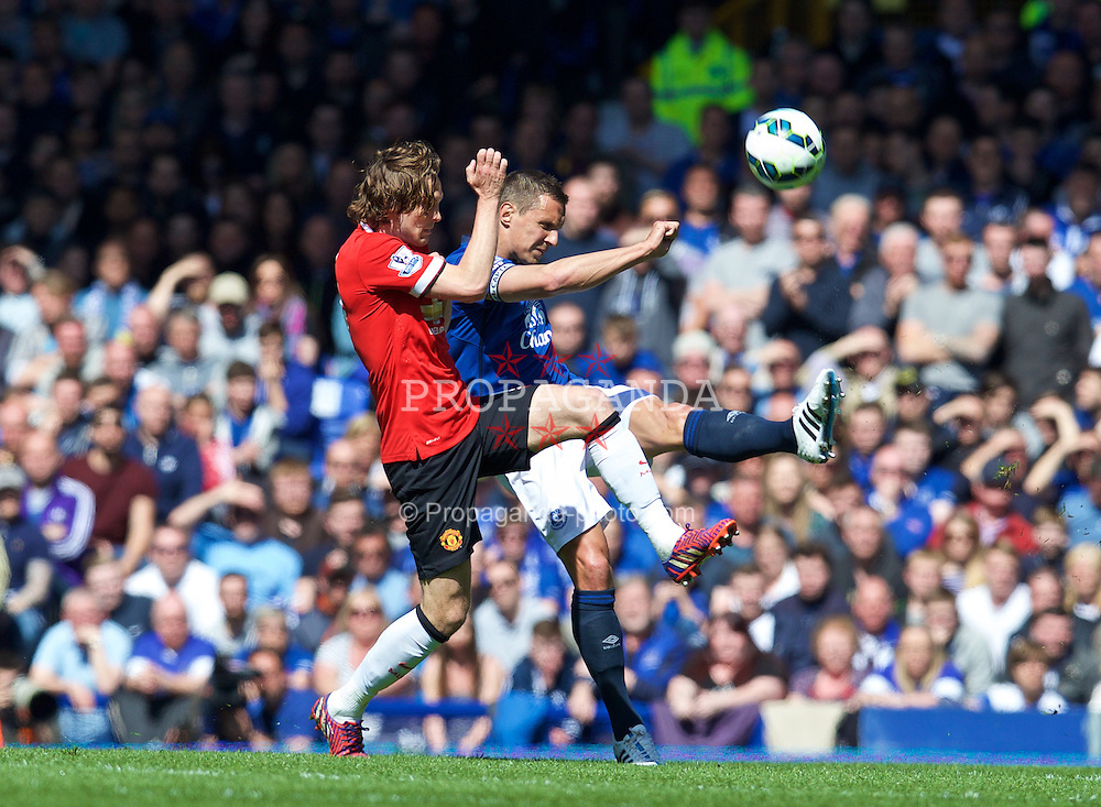 LIVERPOOL, ENGLAND - Sunday, April 26, 2015: Everton's captain Phil Jagielka in action against Manchester United's Daley Blind during the Premier League match at Goodison Park. (Pic by David Rawcliffe/Propaganda)