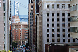 View down Columbus Avenue toward Oakland Bay Bridge, San Francisco, CA.