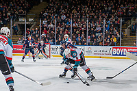 KELOWNA, CANADA - DECEMBER 27: Jack Cowell #8 of the Kelowna Rockets is back checked by Carson Denomie #34 of the Kamloops Blazers on December 27, 2017 at Prospera Place in Kelowna, British Columbia, Canada.  (Photo by Marissa Baecker/Shoot the Breeze)  *** Local Caption ***