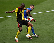 Christian Kabasele of Watford tackles Jamie Vardy of Leicester City during the Premier League match at Vicarage Road, Watford. Picture date: 20th June 2020. Picture credit should read: Darren Staples/Sportimage