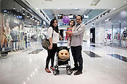 JAKARTA, INDONESIA, MAY 2013:<br /> Denny, Rina and their Daughter Cira spending their Saturday afternoon at the Grand Indonesia Mall,<br /> Grand Indonesia mall, opened 4 years ago, is one of the main attraction in Jakarta for young people and middle class family, May 2013.<br /> &copy; Giulio Di Sturco for Bloomberg Markets