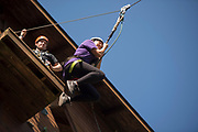 Helen Stec jumps off the zipline platform at The Ridges on Parents Weekend. Photo by Hannah Ruhoff