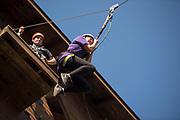 Helen Stec jumps off the zipline platform at The Ridges on Parents Weekend. Photo by Hannah Ruhoff