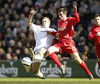Photo: Aidan Ellis.<br /> Liverpool v Bolton Wanderers. The Barclays Premiership. 09/04/2006.<br /> Liverpool's Jamie Carragher holds off Bolton'ss Kevin Davis