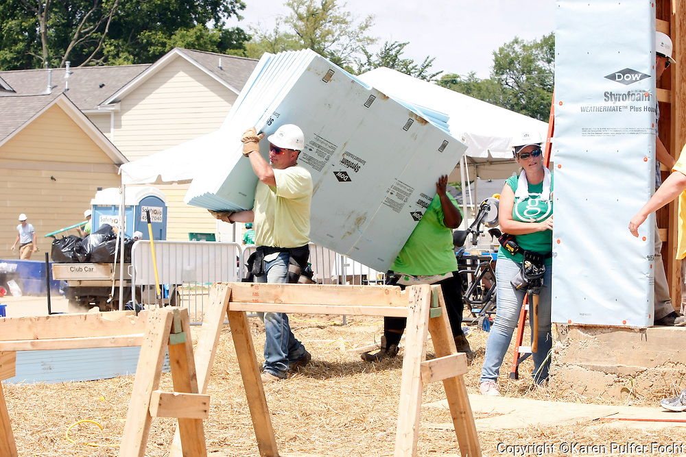 "Singer GARTH BROOKS  (left) and Trisha Yearwood (rt) work on a Habitat for Humanity house in Memphis on Tuesday. They were helping, Former President JIMMY CARTER build homes for the needy in Memphis during the for the 33rd annual Jimmy & Rosalynn Carter Work Project. They're building 19 homes for Habitat for Humanity of Greater Memphis. The former President Jimmy Carter said Monday that he put on ""a false, optimistic face"" and that ""I just thought I had a few weeks to live.""  He announced on Aug. 14, 2015, that he'd had a mass removed from his liver and that he'd been diagnosed with cancer which emerged that melanoma spots had reached his brain. He was onsite with hundreds of volunteers building new homes and a new neighborhood in needy North Memphis."