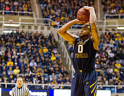 West Virginia Mountaineers guard Jaysean Paige (0) shoots a three pointer against the Oklahoma State Cowboys during the second half at the WVU Coliseum.