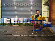 30 JUNE 2016 - BANGKOK, THAILAND: A vendor who stayed open past the 4.30AM deadline for closing at the Pak Khlong Talat sidewalk market. Sidewalk vendors around Pak Khlong Talat, Bangkok's famous flower market, face eviction if they reopen on July 1. As a part of the military government sponsored initiative to clean up Bangkok, city officials have been trying to shut down the sidewalk vendors around the flower market. The vendors were supposed to be gone by the end of March, but city officials relented at the last minute with a compromise allowing vendors to stay until June 30. When vendors dismantled their booths after business on June 30, they weren't sure if they will be allowed to reopen July 1. Some vendors have moved to new locations approved by the government but many have not because they can't afford the higher rents in the new locations.     PHOTO BY JACK KURTZ