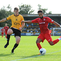 TELFORD COPYRIGHT MIKE SHERIDAN Brendon Daniels of Telford crosses under pressure from Reagan Ogle of Southport during the National League North fixture between Southport and AFC Telford United at Haig Avenue on Saturday, August 24, 2019<br /> <br /> Picture credit: Mike Sheridan<br /> <br /> MS201920-005
