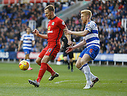 Reading defender, Paul McShane keeps Blackburn Rovers striker, Jordan Rhodes facing away from goal during the Sky Bet Championship match between Reading and Blackburn Rovers at the Madejski Stadium, Reading, England on 20 December 2015. Photo by Andy Walter.