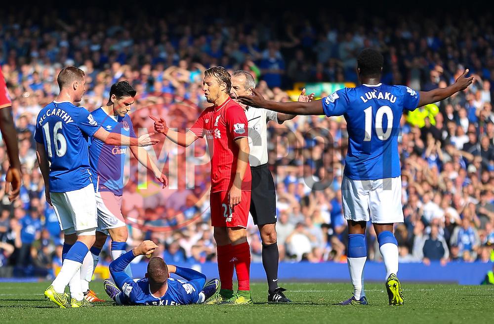 Everton players react after Ross Barkley is fouled - Mandatory byline: Matt McNulty/JMP - 07966 386802 - 04/10/2015 - FOOTBALL - Goodison Park - Liverpool, England - Everton  v Liverpool - Barclays Premier League