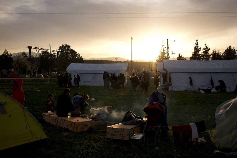 Syrian refugees prepare food on a open fire at the Greek-Macedonian border station of Idomeni, Greece. Around 13,000 migrants and refugees, mostly from the Middle East and African nations, are believe to be stranded here awaiting a chance to proceed their journey towards Germany and other northern European countries.