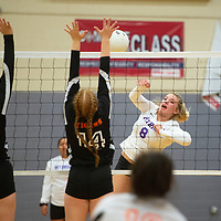 Miyamura Patriot Brooklyn King (8) spikes the ball as Aztec Tigers Kelsey Adams (6) and Madison Edwards (14) jump for the block Tuesday evening at Miyamura High School in Gallup.
