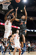Southern California Trojans forward Onyeka Okongwu (21) and Pepperdine Waves center Victor Ohia Obioha (34) go after a rebound during an NCAA college basketball game, Tuesday, Nov. 19, 2019, in Los Angeles. USC defeated Pepperdine 91-84. (Jon Endow/Image of Sport)
