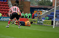 Photo: Peter Phillips.<br /> Wigan Athletic v Sunderland. The Barclays Premiership.<br /> 27/08/2005.<br /> Mike Polltt pushes this Jon Stead effort round his right hand post in the first half