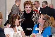 Carie Cottongim of the City of West Carrollton (right) listens to SMRCC president Julia Maxton during the South Metro Regional Chamber of Commerce Holiday Extravaganza at Sycamore Creek Country Club in Springboro, Wednesday, December 14, 2011.