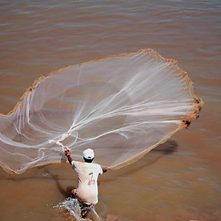 A fisherman casts his net in the Tonle Sap rvier in the city of Phnom Penh, Cambodia.
