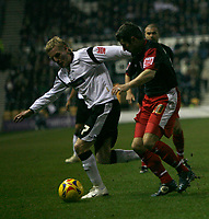 Andy Griffin of Stoke City (right) tussles with Gary Teale  of Derby County (right)