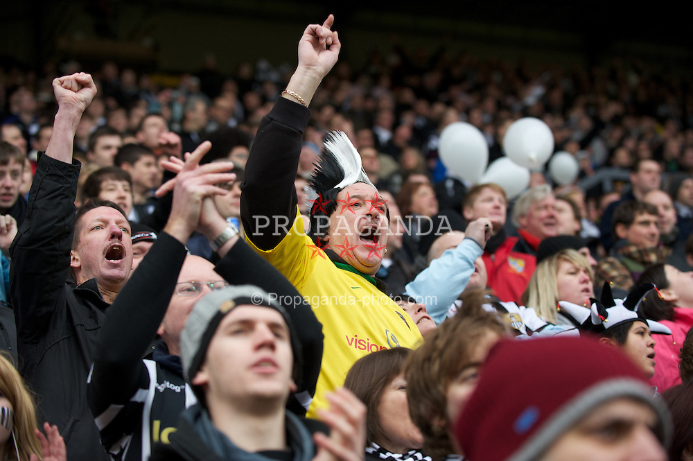 NOTTINGHAM, ENGLAND - Sunday, January 30, 2011: A Notts County supporter cheers his side on during the FA Cup 4th Round match against Manchester City at Meadow Lane. (Photo by David Rawcliffe/Propaganda)