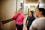 Napoli, Italia - 11 dicembre 2010. Alcune signore che abitano nell'albergo Vergilius discutono animatamente nei corridoi dell'hotel..Ph. Roberto Salomone Ag. Controluce.ITALY - Women that live inside Vergilius hotel argue in the corridors of the hotel in Naples on December 11, 2010.