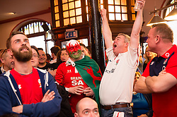 © London News Pictures. 12/03/2016 Aberystwyth, Wales, UK. Brave Englishman JOHN HARRINGTON shares a drink with Welsh rugby fans in the Castle Hotel Aberystwyth, watching television coverage of Wales playing England in the Six Nations rugby international series. Photo credit: Keith Morris/LNP