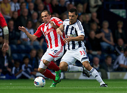 WEST BROMWICH, ENGLAND - Sunday, August 28, 2011: Stoke City's Matthew Etherington in action against West Bromwich Albion's Paul Scharner during the Premiership match at the Hawthorns. (Pic by David Rawcliffe/Propaganda)