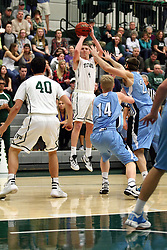 20 February 2016:  Andy Stempel(4) shoots a long 3 pointer during an NCAA men's division 3 CCIW basketball game between the Elmhurst Bluejays and the Illinois Wesleyan Titans in Shirk Center, Bloomington IL