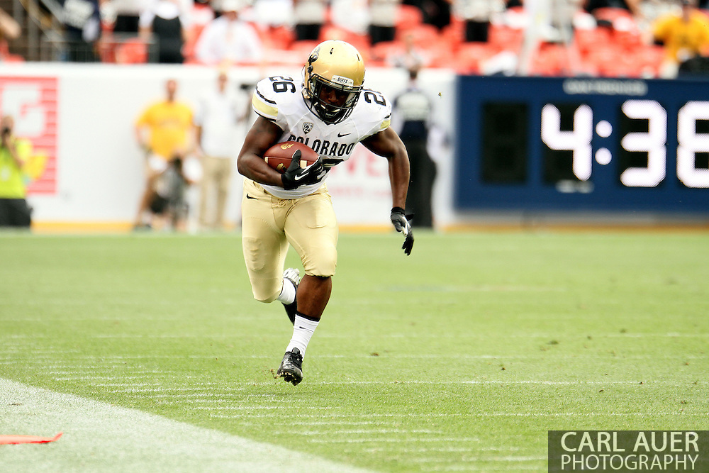 September 1st, 2013 - Colorado Buffaloes junior tail back Tony Jones (26) sprints the ball up field towards the first down marker in the first half of the NCAA football game between the Colorado Buffaloes and the Colorado State Rams at Sports Authority Field in Denver, CO
