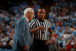 CHAPEL HILL, NC - FEBRUARY 05: Head coach Roy Williams of the North Carolina Tar Heels talks to referee Michael Stevens during a game against the North Carolina State Wolfpack on February 05, 2019 at the Dean Smith Center in Chapel Hill, North Carolina. North Carolina won 113-96. (Photo by Peyton Williams/UNC/Getty Images) *** Local Caption *** Roy Williams;Michael Stevens