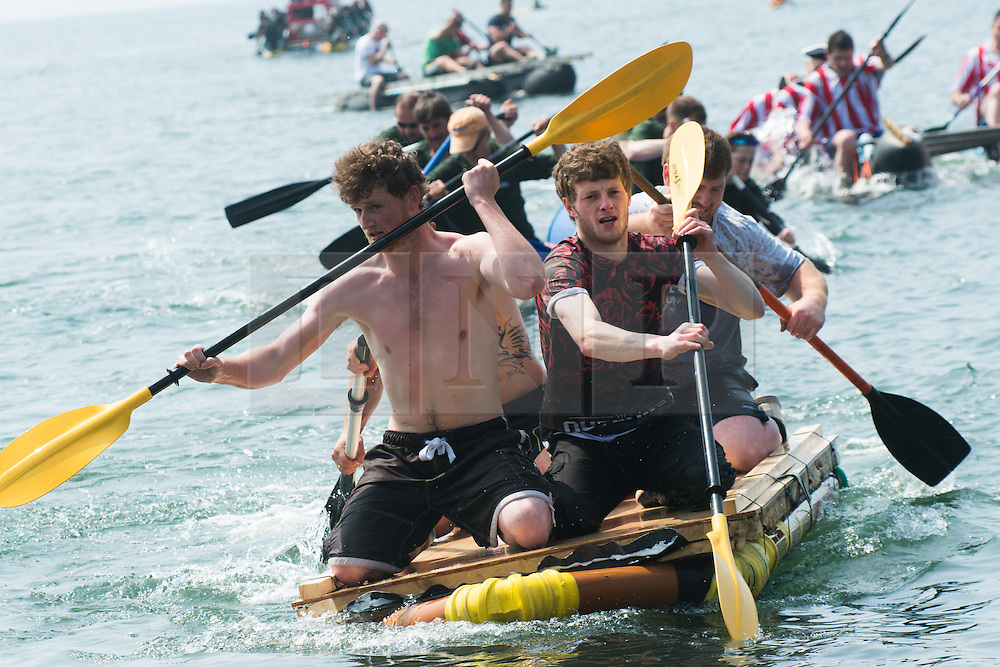 © Licensed to London News Pictures. 29/05/2016. Aberystwyth, Wales, UK. On a fine sunny and very warm Sunday afternoon, people take part in the annual charity raft race in the sea outside the Glengower Hotel (the organizers of the event) in Aberystwyth on the coast of Cardigan Bay, west Wales.  Photo credit: Keith Morris/LNP