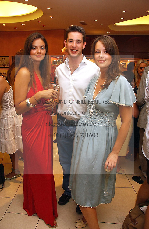 Left to right, LADY NATASHA RUFUS-ISAACS, the HON.JAMES TOLLEMACHE and ARABELLA MUSGRAVE at a party hosted by Links at their store in Sloane Square, London to celebrate the forthcoming Glorious Goodwood Racing festival held on 26th July 2006.<br /><br />NON EXCLUSIVE - WORLD RIGHTS