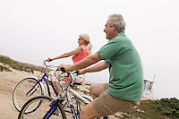 Middle-aged couple riding bicycles