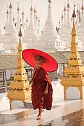 Monk with umbrella, Kutho Taur Pagaoda of 729 marble slabs, Mandalay, Burma