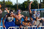 The Hampton Pirates Men's Basketball Team show their support during the Hampton - Tennessee Tech football game at Armstrong Stadium in Hampton, Virginia.  Tech won 30-27.  September 14, 2013  (Photo by Mark W. Sutton)