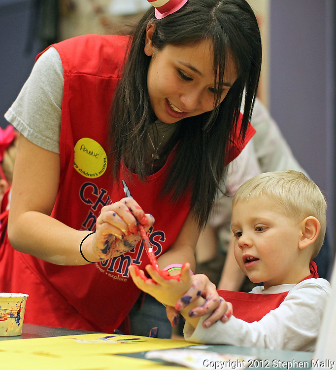 Arlene Freudenberg (from left) of Cedar Falls paints the hand of Grady Dettbarn, 4, of Marion, has he makes a picture of Thing One during Dr. Seuss Day Celebration at the Iowa Children's Museum, 1451 Coral Ridge Ave in Coralville on Saturday afternoon, March 3, 2012. Freudenberg is a student at the University of Iowa. (Stephen Mally/Freelance)