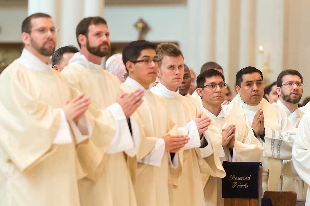 DENVER, CO - MAY 16: From left, the Rev. Gregory Louis Lesher, the Rev. Joseph Marc McLagan, the Rev. Erik Vigil Reyes, the Rev. Tomasz Strzebonski, the Rev. Franklin Anastacio Sequeira Treminio look on during their ordination as priests in the Archdiocese of Denver at the Cathedral Basilica of the Immaculate Conception on May 16, 2015, in Denver, Colorado. (Photo by Daniel Petty/Denver Catholic Register)