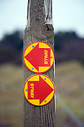 Byway signs on wooden post pointing two different directions