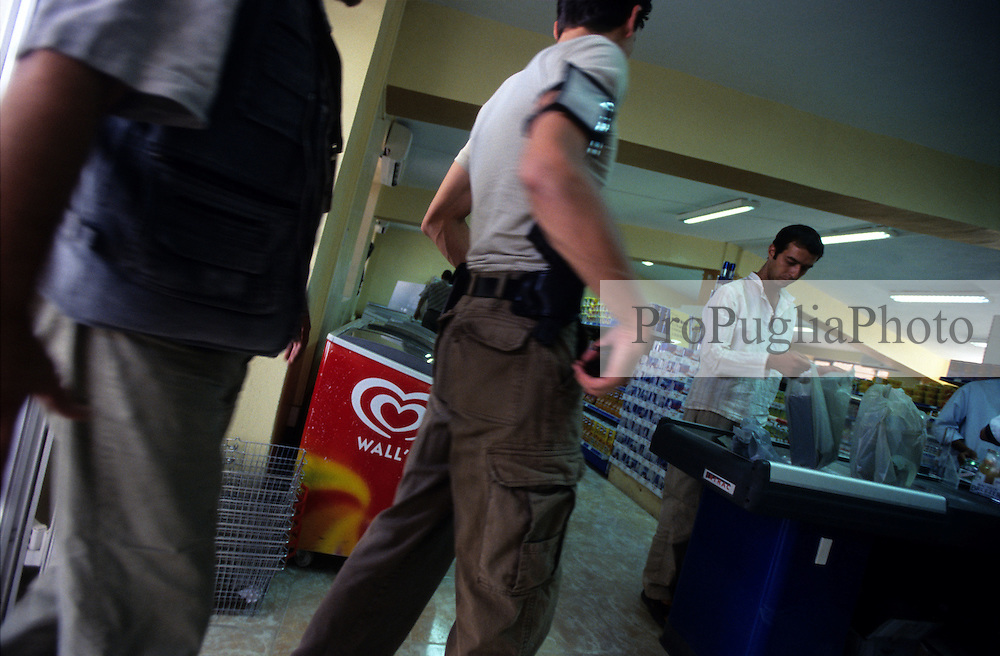Kabul, 17 July 2005..A  soldier goes shopping in a supermarket on Jalalabad road..Only foreigners with passport or special ID have access to this western's style shop.