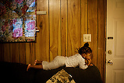 "Gabby, 2, watches TV in the apartment she shares with her mother, Lettorea ""Lottie"" Clark, 25, in Albany, GA on Wednesday, October 24, 2008. Lottie and Gabby live off welfare after escaping an abusive relationship with Gabby's father."
