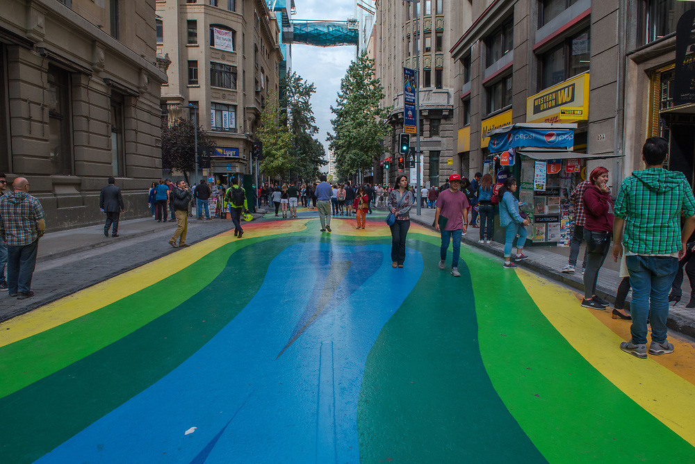 Santiago, Chile--April 6, 2018. People are walking and window shopping along a brightly painted street in Santiago, Chile.  Editorial use only.
