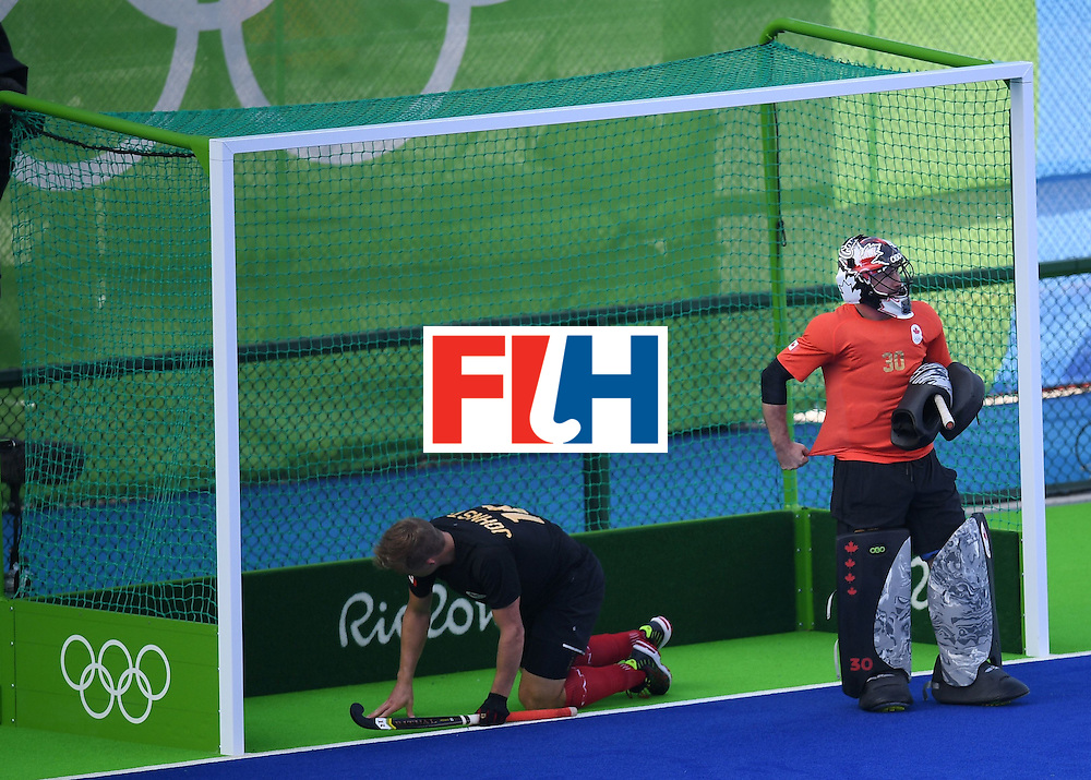 Canada's goal keeper David Carter (R) and Canada's Gordon Johnston react during the men's field hockey Ireland vs Canada match of the Rio 2016 Olympics Games at the Olympic Hockey Centre in Rio de Janeiro on August, 11 2016. / AFP / MANAN VATSYAYANA        (Photo credit should read MANAN VATSYAYANA/AFP/Getty Images)