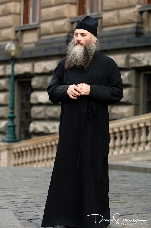 Orthodox Priest in Prague Town Square