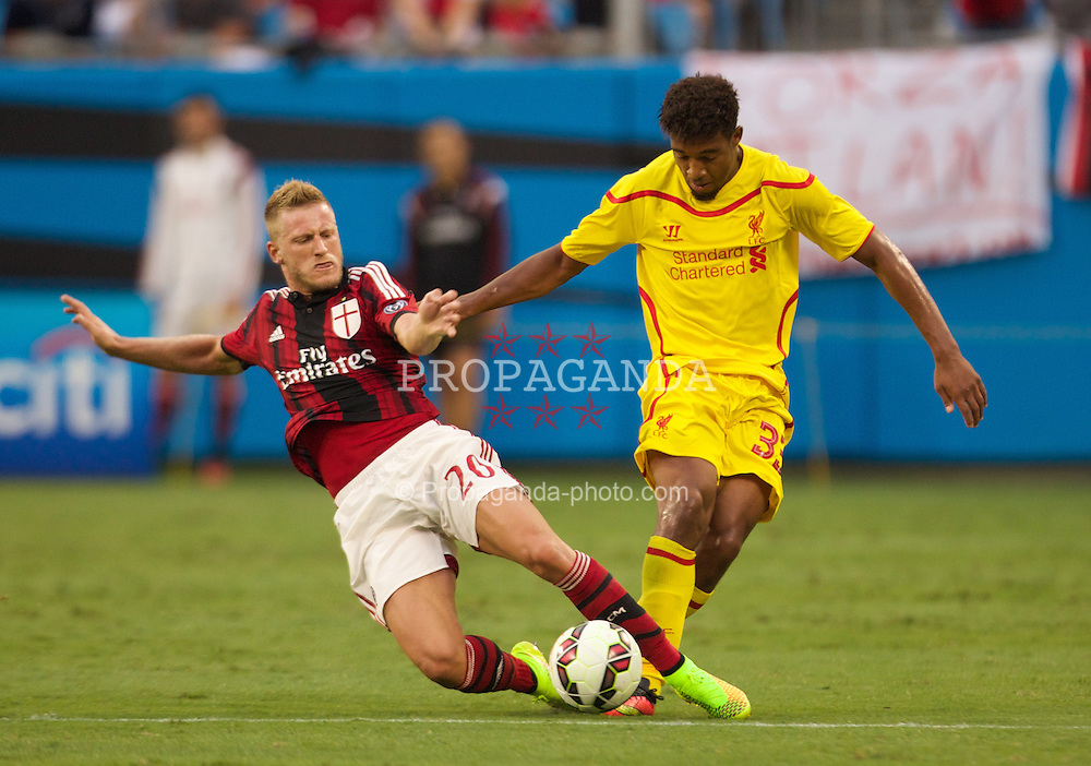 CHARLOTTE, USA - Saturday, August 2, 2014: Liverpool's Jordon Ibe in action against AC Milan's Ignazio Abate during the International Champions Cup Group B match at the Bank of America Stadium on day thirteen of the club's USA Tour. (Pic by Mark Davison/Propaganda)