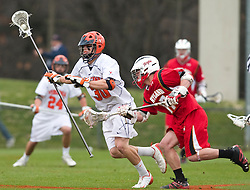 Virginia Cavaliers D Bray Malphrus (30) avoids Maryland Terrapins SSM Bryn Holmes (17) on a clear.  The #9 ranked Maryland Terrapins fell to the #1 ranked Virginia Cavaliers 10 in 7 overtimes in Men's NCAA Lacrosse at Klockner Stadium on the Grounds of the University of Virginia in Charlottesville, VA on March 28, 2009.