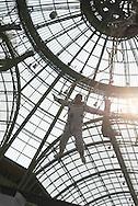 France. Paris Art Paris. Art Fair .in The Grand Palais Li Wei performance, dressed as a cosmonaut. / art Paris, Art Fair Foire dans le Grand Palais . La performance de Li Wei, suspendu dans la verrière du Grand Palais, dans le cadre de Art Fair Art Paris le 27 mars 2014
