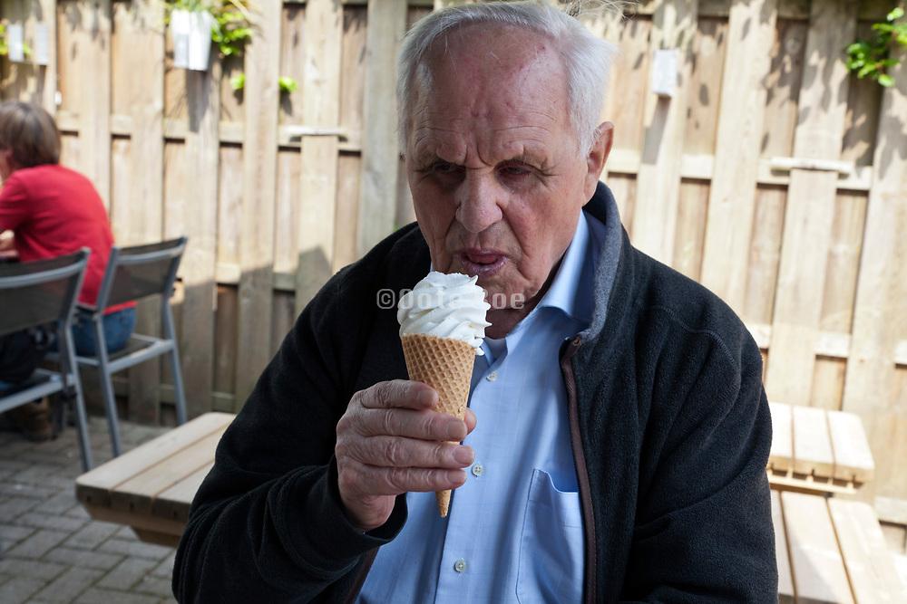 senior man enjoying a soft ice cream